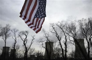 U.S. flag flies near cooling towers of Three Mile Island nuclear power plant, where U.S. suffered its most serious nuclear accident, in Middletown, Pennsylvania